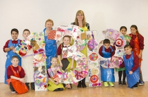 Bridget Lindsay and Gail McGarvey from Play Resource pictured with pupils from St Mary's Primary School who recently created an 13p artwork to show their support and raise awareness of the 13P campaign,
