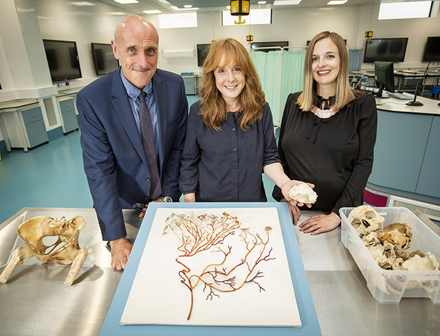 Pictured (L-R) are Mr Ian K Walsh, Queen's University Centre for Medical Education, artist, Andrea Spencer and Joanna Johnston, Arts Council.