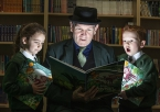 Damian Smyth, Arts Council of Northern Ireland, with Carryduff St Josephs pupils ,Muireann Quinn and Conal Caughey, at an announcement to distribute free books to every primary one child in Northern Ireland.