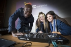 Pictured are DJ Kwame Daniels from Bounce Culture with Katie Jones and Jodie McCune from Ashfield Girls.