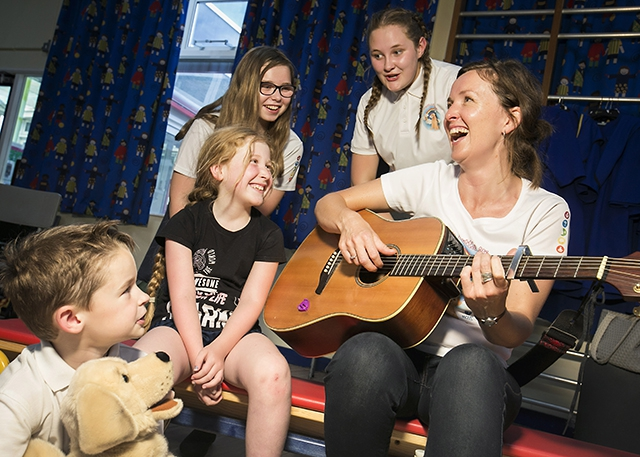 Mentors Shannan Barrett, Antrim Grammar School and Hannah Brennan, Sperrins Integrated College are pictured with Aidan Tracy (7), Cailin Simpson, (9), with Una McCann, Professional Musician, Songwriter and Community Choir leader