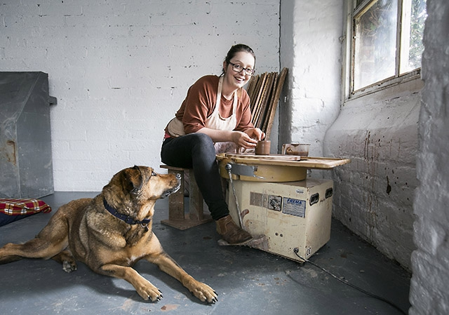 Pictured is Ceramicist and Game of Thrones prop maker, Helen Faulkner with studio assistant, Sheva the dog.