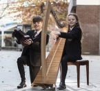 Pictured helping to launch the scheme are Críostóir Ó Bradáin (13) and Gráinne Ní Bhradaín (11) from the Armagh Pipers Club.