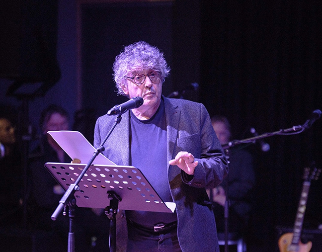 Paul Muldoon on stage at Seamus Heaney HomePlace
