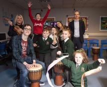 Pictured are: Project Sparks leaders Owen Coyle, Sarah-Jane Murray and Courtney Hamilton, project manager Eamonn McCarron and Gilly Campbell from the Arts Council of Northern Ireland with pupils from Greenhaw Primary School.