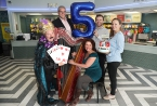 Actress Christina Nelson, Gavin Robinson MP, harpist Ursula Burns, Councillor Peter McReynolds and Chief Executive Mimi Turtle celebrate the Strand's 5th anniversary as an arts centre