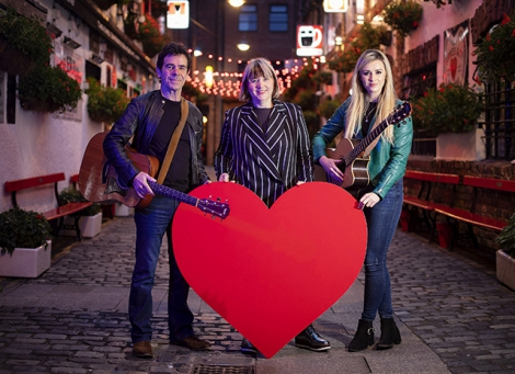 Pictured is Susan Picken, Director of Cathedral Quarter Trust with Davy Watson and Triona who will peform live at the Cool FM stage outside Castle Court from 7pm on Culture Night