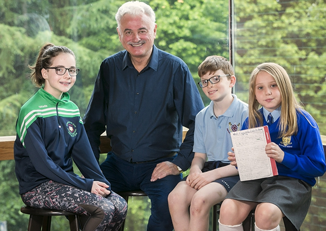 Poet Frank Galligan is pictured taking to students Isobella McCrudden (9) from St Theresa's P.S , Belfast,  Jonathan Graham (10), Antertaine.P.S, Maghera and Anna O'Connor, St Patrick's P.S Maghera at the closing event.