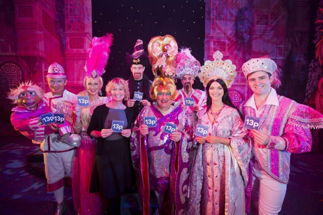 The cast of Aladdin pictured alongside the Arts Council's Sonya Whitefield support the No More Cuts to the Arts campaign.